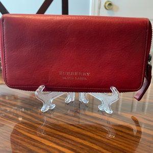 Burberry Zip wallet,clean interior 12 CC slots